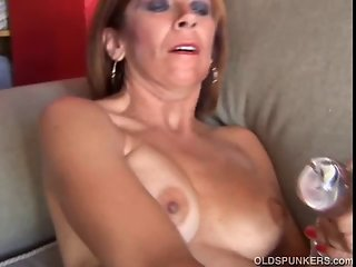 Mature redhead amateur with nice tits shows you how she