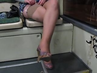 Baby flashing her stockings, panties and tits in a bus