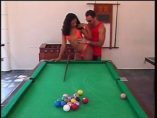 A brunette tranny fucked in the ass by huge cock on top of billiards table