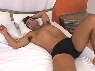 Brunette transsexual sucks cock and gets fucked in bed