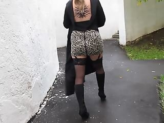 Girl in miniskirt and stockings going upstairs